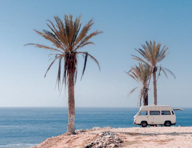 VW Bus am Strand Rabattcoupons